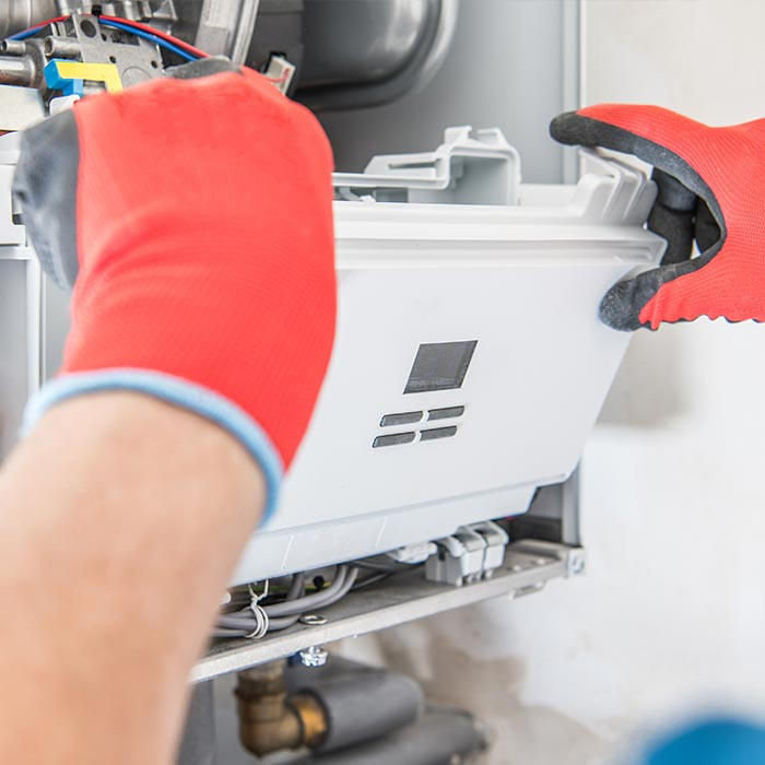 Commercial-plumbing-and-heating-services-Plymouth---fixing-boiler---Phil-Crews-commercial-gas-services